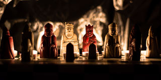 Lewis chess men replica set. A replica of the Lewis chess men photographed by candlelight royalty free stock images