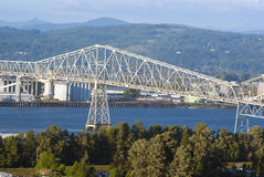 Lewis and Clark Bridge over Columbia river. And industrial zone Stock Photo