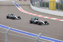Lewis Hamilton of Mercedes AMG Petronas F1 Team leads Nico Rosberg Mercedes AMG Petronas Formula 1 Team. Sochi, Russia - October 11, 2015: Lewis Hamilton of Royalty Free Stock Photos