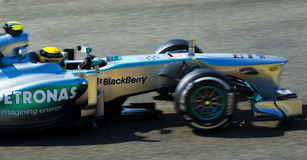 Lewis Hamilton Mercedes. Lewis Hamilton passes by while taking part in an afternoon practice session in Spa Royalty Free Stock Photo