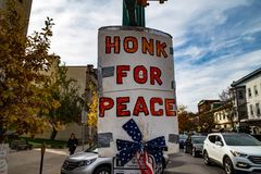 The Honk for Peace Sign. Lewisburg, PA - November 4, 2017: A Honk for Peace sign on a pole in the downtown area stock image