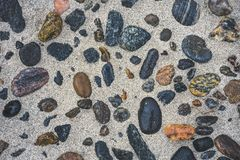 Pebbles in the sand on the beach. Lewisian gneiss pebbles in the sand, beach on the Isle of Lewis, Outer Hebrides, Scotland Royalty Free Stock Photo