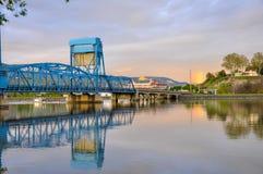 Lewiston - Clarkston blue bridge reflecting in the Snake River against evening sky on the border of Idaho and Washington states.  stock photo