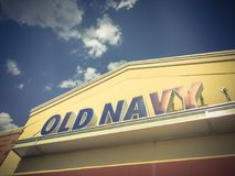 Exterior of Old Navy clothing and accessories retailing company. LEWISVILLE, TX, USA-JUL 1, 2018:Close-up logo facade exterior of Old Navy chain store. Clothing Royalty Free Stock Image