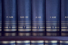 Lexicon on a bookshelf Stock Images