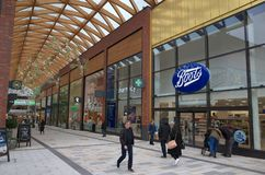 The Lexicon Shopping Center in Bracknell, England. Bracknell, England - Nov 22, 2017: People passing by the Boots store in the Lexicon shopping center, opened in Stock Images