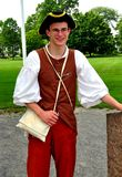 Lexington, MA: Guide in Colonial Clothing. Lexington, Massachusetts:  Re-enactor guide dressed in colonial period clothing standing on the Village Green where Royalty Free Stock Photography