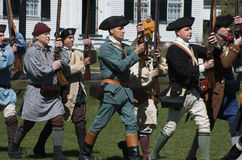 Lexington Minutemen. A group of Lexington minutemen marching at a reenactment of the Revolutionary war. It took place on the Battlegreen in Lexington, MA, USA Stock Image