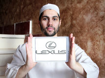 Lexus car logo. Logo of lexus car brand on samsung tablet holded by arab muslim man Royalty Free Stock Image