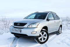 Lexus RX330. NOVYY URENGOY, RUSSIA - NOVEMBER 5, 2016: Silver motor car Lexus RX330 in the snow covered tundra Royalty Free Stock Image