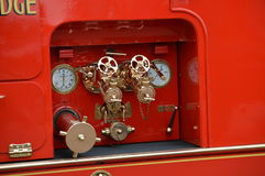 1939 Leyland FK9 Fire Appliance. Pump equipment on a 1939 Leyland fire engine showing dials and brass valves royalty free stock images