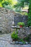 Lezzeno back street. Detail of lezzeno back street,pavement and stone wall in italy Stock Photo