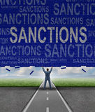 Lfting Sanctions. Lifting Sanctions as a global economic symbol for solutions to trade disputes as a man lifting a brick wall with words as a metaphor for Stock Image