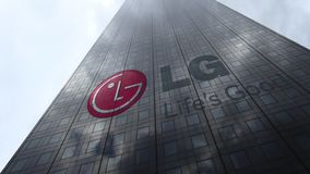 LG Corporation logo on a skyscraper facade reflecting clouds, time lapse. Editorial 3D rendering. LG Corporation logo on a skyscraper facade reflecting clouds stock video footage