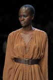 LG Fashion Week. TORONTO - OCTOBER 16: A model walks down the runway showcasing the spring/summer 2012 collection from Arthur Mendonça during Toronto's LG royalty free stock image