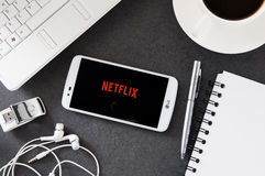 LG K10 with Netflix application laying on desk. Royalty Free Stock Image