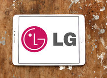 Lg logo. Logo of electronics company lg on samsung tablet on wooden background Royalty Free Stock Photography