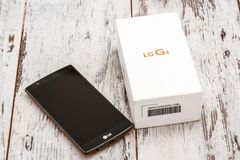LG Smartphone on Wooden White Background royalty free stock photos