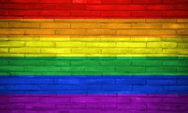 LGBT civil rights rainbow flag painted on bricks wall. Copy space for text or graphic. royalty free stock photo