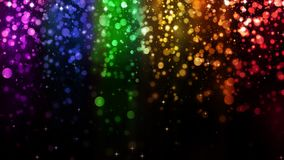 LGBT color bokeh festive background with shiny falling particles, rainbow colorful abstract graphic for bright design. Gay lesbian