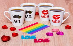 Four cups of coffee for friends, rainbow flag, love and hearts Stock Photography