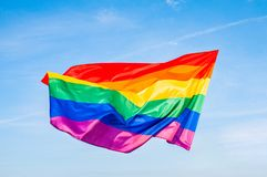LGBT flag on blue sky. Gay Rainbow flag. LGBT community, freedom and love concept for same sex couples royalty free stock photo