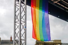 LGBT flag on main stage of Pride Festival Weekend in Love Northampton Market Square.  royalty free stock photos