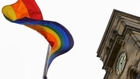 LGBT flag over Northampton Guildhall building on Pride Festival Weekend in UK.  stock photo