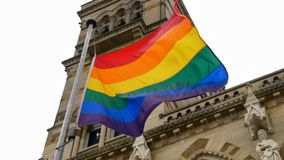 LGBT flag over Northampton Guildhall building on Pride Festival Weekend in UK.  royalty free stock photography
