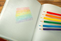 LGBT flag drawn in a school notebook / education on tolerance. Lgbt flag painted school board tolerance learning concept drawn notebook education royalty free stock photography