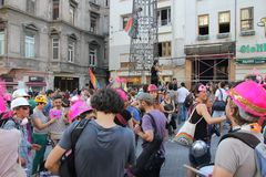 LGBT Lesbian, Gay, Bisexual, Transsexual pride march in Istiklal Street. ISTANBUL, TURKEY, JUNE 24, 2013: a man with pink hat marches during the LGBT Lesbian royalty free stock photo