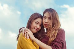 LGBT lesbian women couple moments happiness. Lesbian women couple together outdoors concept. Lesbian couple embraced together relation fall in love. Two asian Stock Images