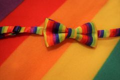 Lgbt pride bow on a multicolor background stock photo