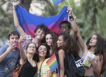 LGBT pride celebrations in mallorca people taking a selfie. People take a selfie during LGBT pride day celebrations in the street of palma de mallorca. LGBT, or stock photography