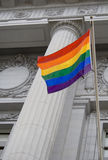 LGBT pride flag. Lesbian, gay, bisexual, and transgender pride flag flying outside a government building stock photography