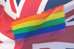 LGBT Rainbow flag blended with Union Jack Flag. Double Exposure of Rainbow Flag and Great Britain Flag, Abstract photography shallow depth of field royalty free stock image