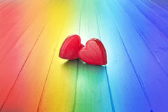 Rainbow Love Heart Marriage Background. A conceptual image of two love hearts on a rainbow background Royalty Free Stock Images