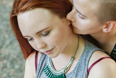 LGBT women. Young lesbian couple walking in the park together. Delicate relationship. The notion of same-sex marriage Stock Images