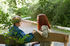 LGBT women. Young lesbian couple walking in the park together. Delicate relationship. Selective focus. LGBT women. Young lesbian couple walking in the park Stock Photos