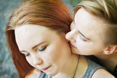 LGBT women. Young lesbian couple walking in the park together. Delicate relationship. Selective focus. Stock Photography