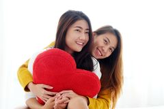 LGBT, Young cute asia lesbians huging and holding red heart shap. E willow together with happy smiling, couple lesbians, valentine`s day concept Stock Photography