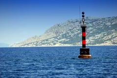 Lghthouse en mer près de l'île PAG en Dalmatie, Croatie Images libres de droits