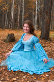 Lgirl in medieval dress in autumn wood Stock Images
