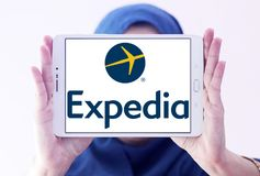Expedia logo. Lgoo of Expedia on samsung tablet holded by arab muslim woman. Expedia.com is a travel website owned by Expedia Inc. The website can be used to Royalty Free Stock Photography