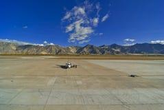 Lhasa airport Tibet. Single aircraft on tarmac of Lhasa airport, Tibet Stock Photo
