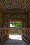 Lhuentse Dzong in Eastern Bhutan - Asia. Lhuentse Dzong monastery in Eastern Bhutan - Asia - rich decorated entrance gate with prayer wheels stock images
