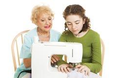 Lição Sewing da família Imagem de Stock
