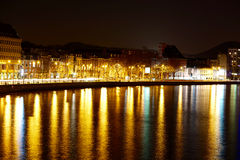 Liège by night. Colored belgium town Liège mirroring in a river by night Stock Photography