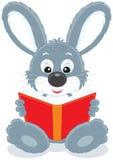 Lièvres affichant un livre illustration stock