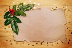 Liścia ostrokrzew i papier Obrazy Stock